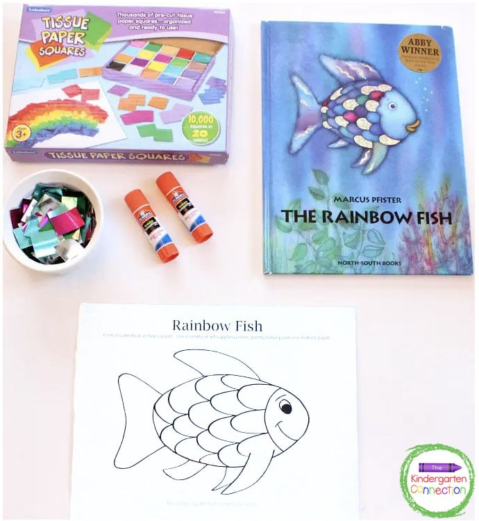Grab some tissue paper, glue sticks and our free printable for some Rainbow Fish craft fun!