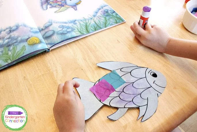 Cut out your rainbow fish and begin gluing tissue paper scales wherever you choose.