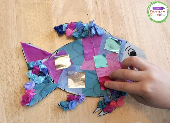 Once Rainbow Fish is decorated to your child's liking, then add the final touch...his shiny scales!