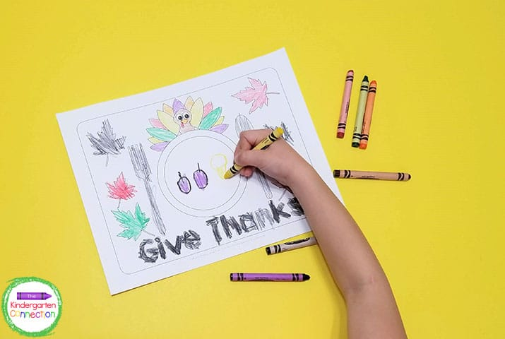 These placemats include fall leaves and a fun turkey to color, with the turkey peeking from behind the plate.