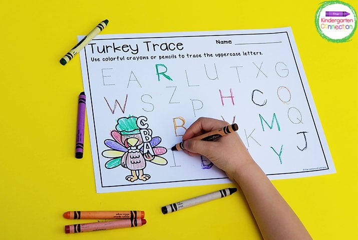 Students work on penmanship by tracing all of the letters in a variety of rainbow colors.