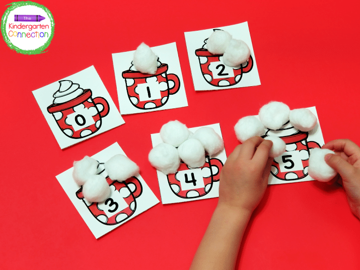 "Use the number set as counting cards with white pom poms as ""marshmallow"" counters!"