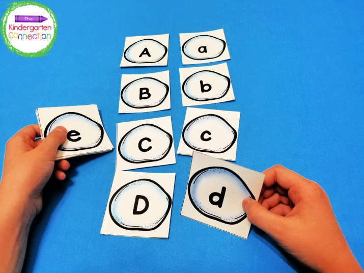 The alphabet card set includes snowball cards with letters A-Z (in both upper and lowercase).