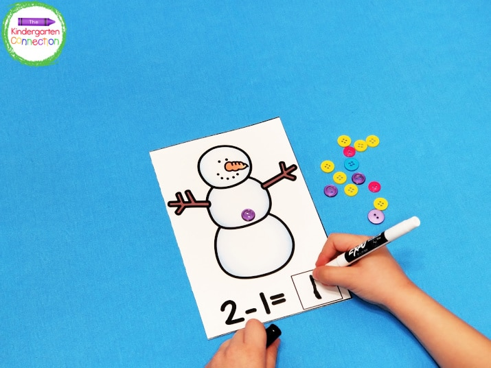 Laminate the free snowman printable, grab some colorful buttons and dry erase markers, and you have a math center ready to go!