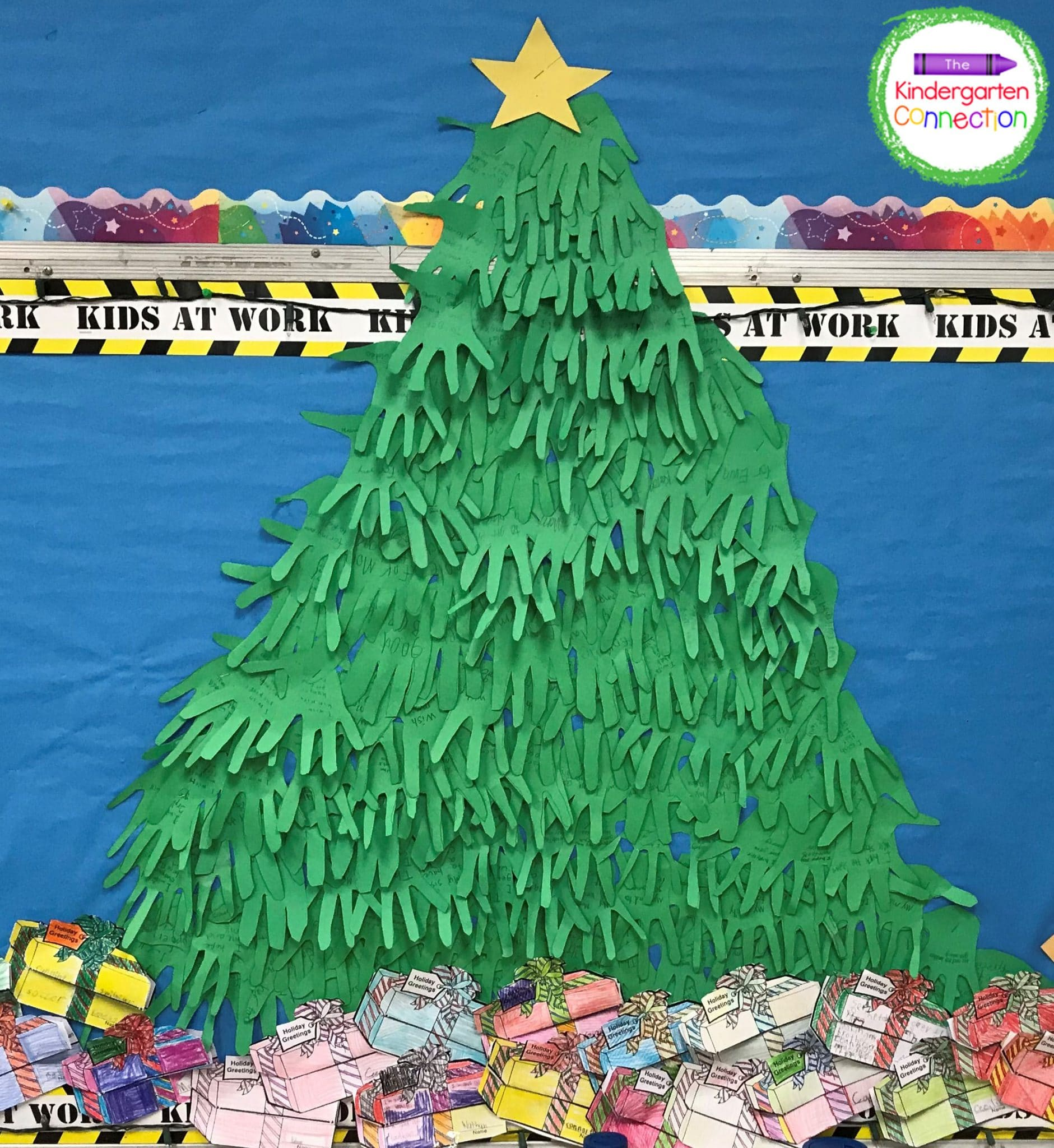 Create fun holiday bulletin boards like this handprint Christmas tree.