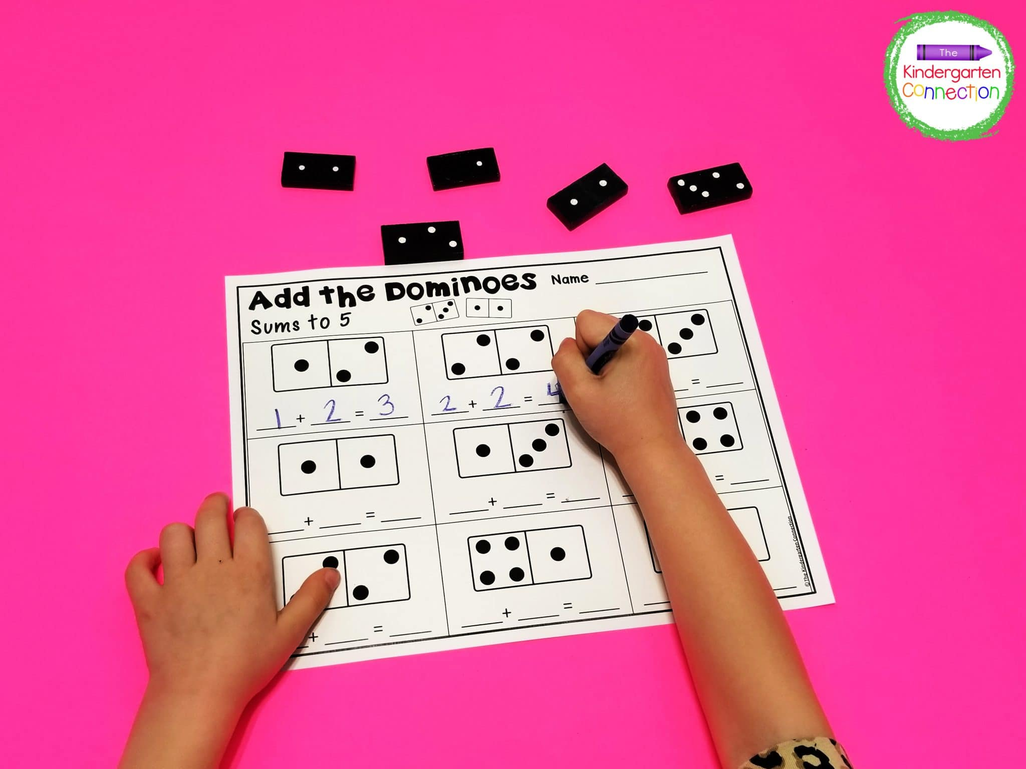 Just print out the free domino addition printables and grab some dominoes for a super fun math center.