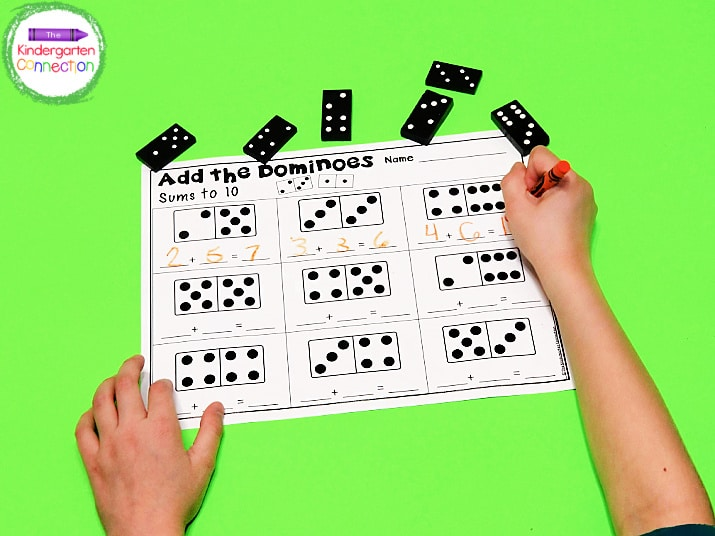 Students pick a domino, record the two numbers on the recording sheet, and add to find the sum!