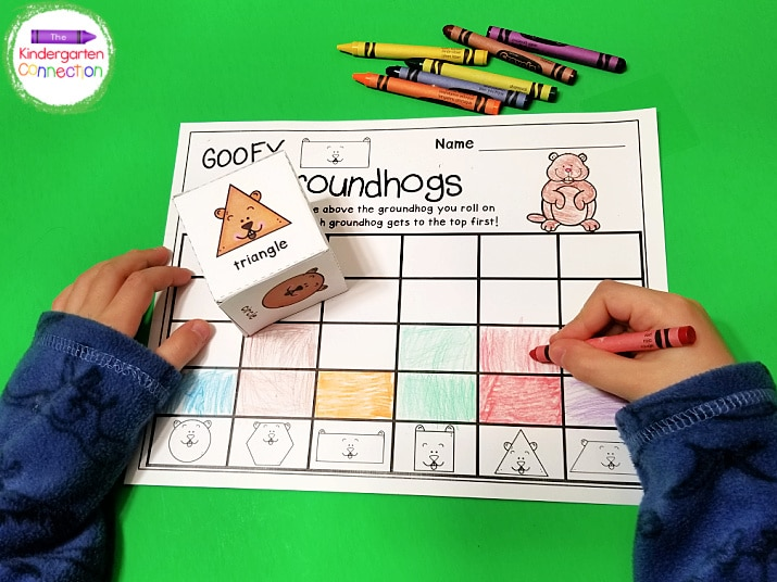 Students roll the die and color one square above the matching shape on their roll and graph recording sheet.