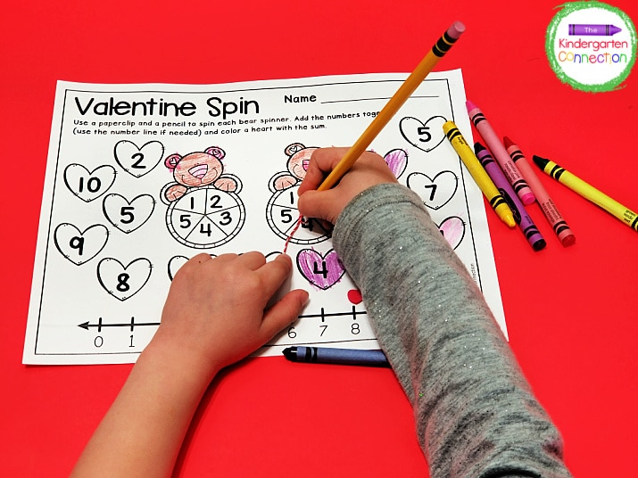 For this Valentine addition game, simply place the pencil inside the paperclip, give it a flick with your finger, and see what numbers to add.