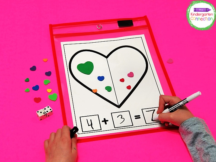 Students practice adding 2 numbers while using the heart manipulatives as a visual representation of the equation.