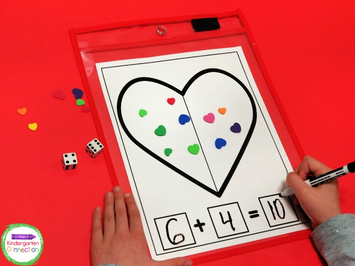 With these heart addition math mats, they are counting, writing, and adding.