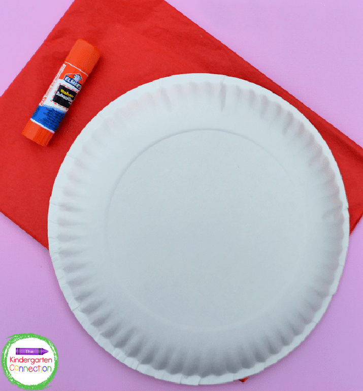 This craft needs just a few simple supplies: tissue paper, a paper plate, and a glue stick.