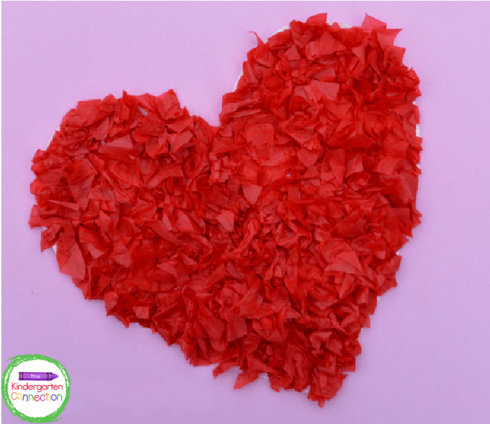 This tissue paper Valentine heart craft is simple but so cute and fun.