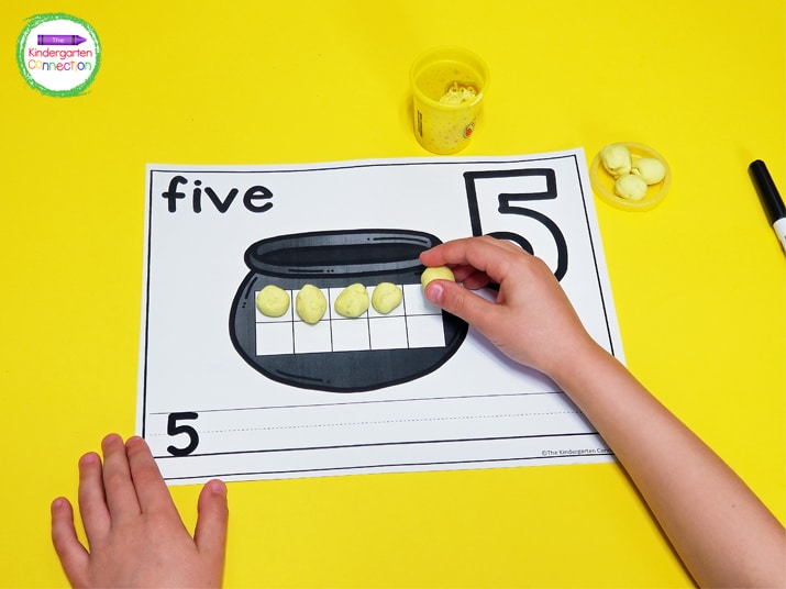 Roll the yellow play dough into balls to make the gold coins for counting and adding to the pot of gold.
