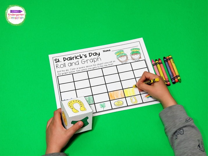 Students roll the die and color one square above the matching St. Patrick's Day picture on their roll and graph recording sheet.