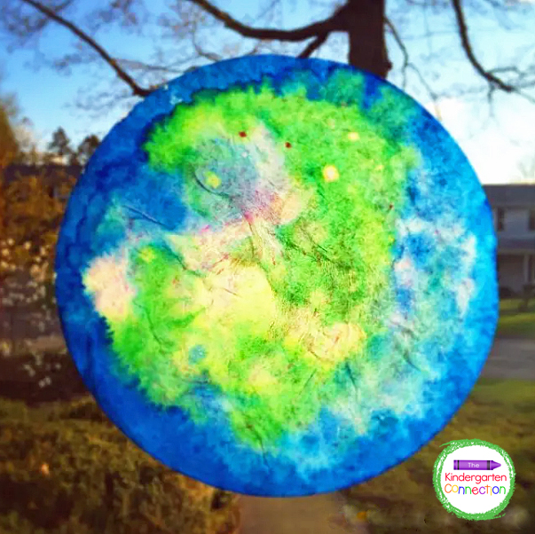 Use washable glue sticks to attach the Earth suncatchers to a window for a stunning display.