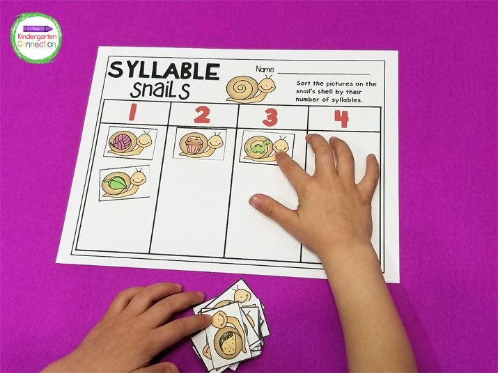 In Syllable Snails, the kids pick a snail picture card and add it to the column with the correct number of syllables on the recording sheet.