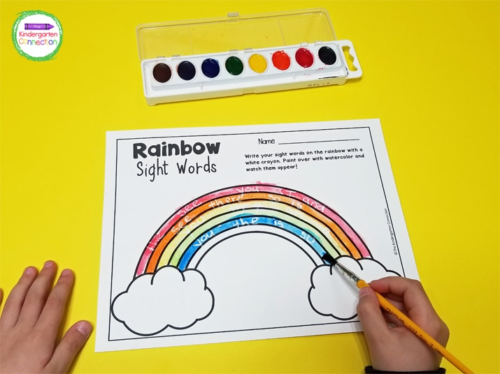 To begin, we write our sight words within the rainbow in white crayon. Be sure to write in the open spaces.