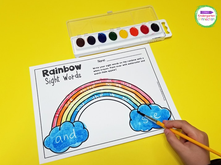 Immediately the rainbow sight words become visible through the paint. We even write on and paint the clouds.