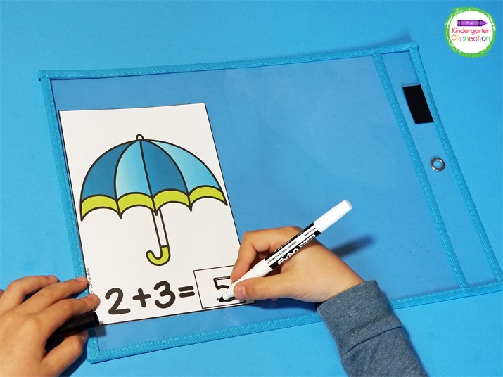 Solve addition equations within 5 and 10 with these umbrella math mats.