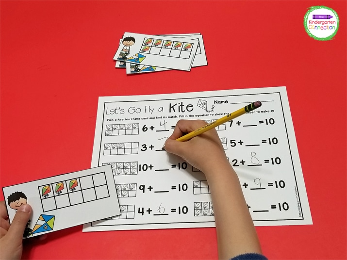 Students pick a kite ten frame card and find its match on the recording sheet.