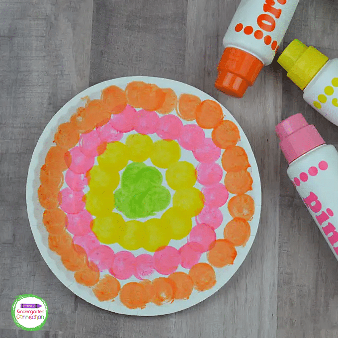 Alternate stamping colors and fill in the center of your spring flower with one final color.