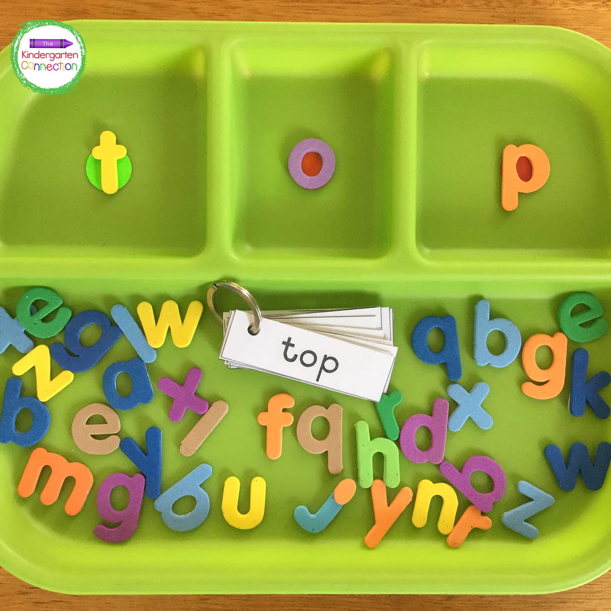 I use simple CVC word cards on a key ring for students to flip through and spell with their letter manipulatives.