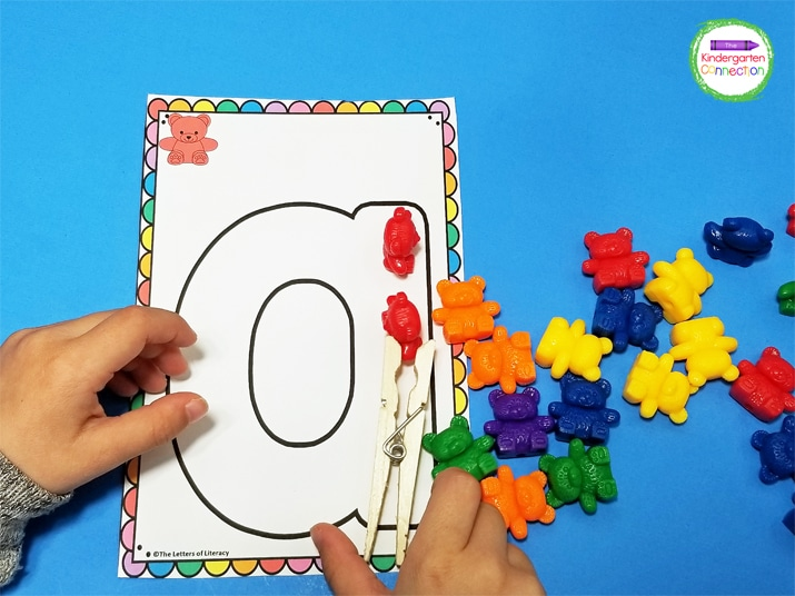 As a challenge, kids can use the clothespin to pick up the counting bears carefully and transfer them onto the letters.