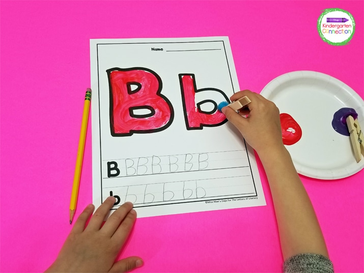 Have the kids dab the clothespin pom pom paintbrush into a paint color of their choice and start filling up their letter.