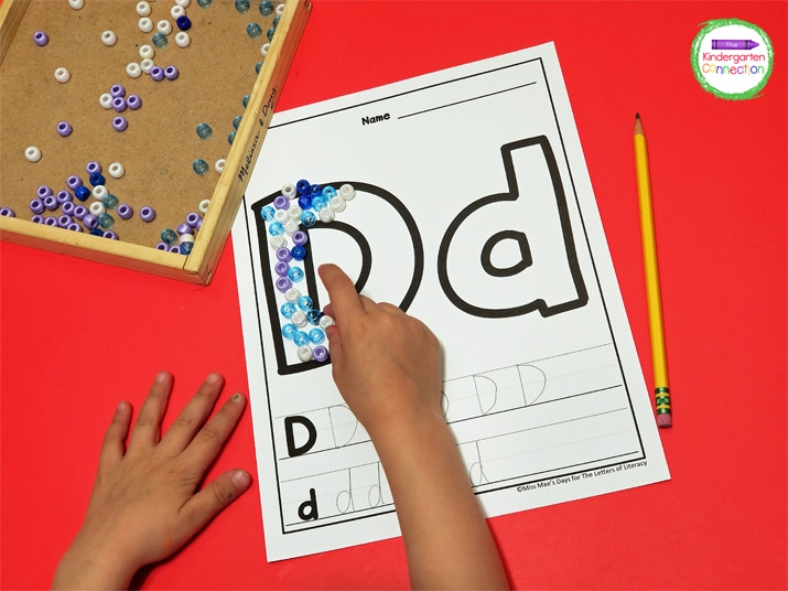 Instead of paint, children can cover the letters with small beads to work those fine motor muscles in a similar way!