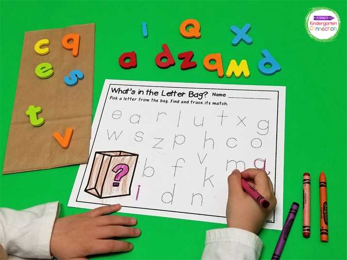 Just grab the free printable, letter manipulatives, and a bag or basket for a quick and fun literacy center!