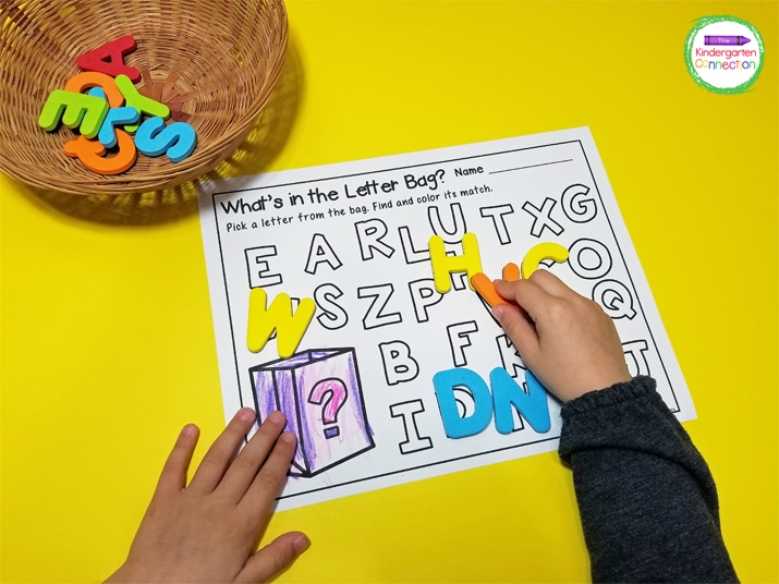 Use the alphabet printable and those letter recognition skills to find and place the letter manipulatives on the matching letters.