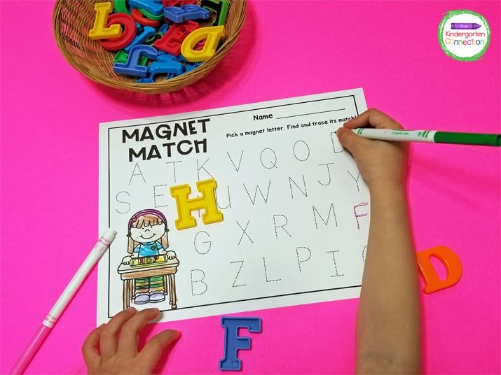 The kids just pull a letter magnet from the basket, find its match on the recording sheet, and trace over it.