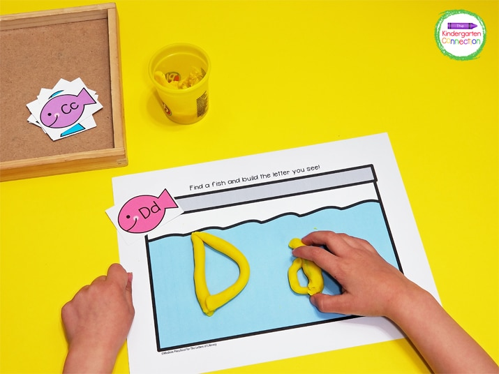 Simply pick a fish card and identify the letter on it. Then, build the letter out of play dough on the fish tank mat.