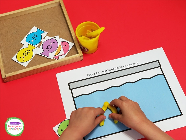 This activity includes a fish tank mat for building play dough letters and 26 colorful fish cards.