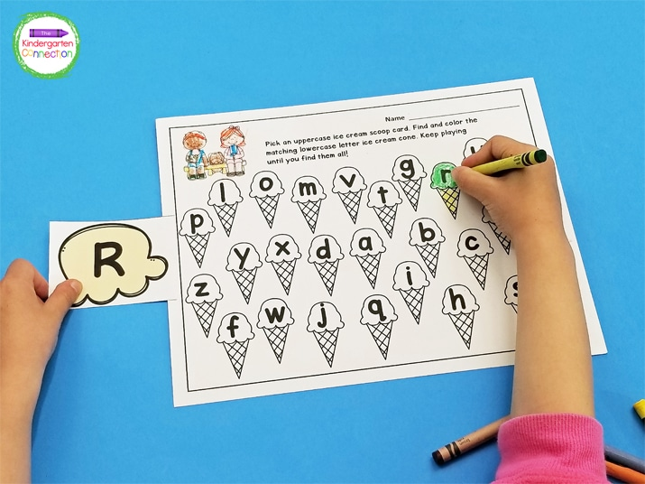 Students pick an ice cream scoop letter card and color the matching letter on the recording sheet.