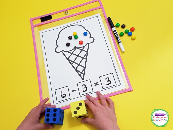 For the subtraction math mat, the ice cream cone only has one part that we will be taking away from. Roll the die to begin.