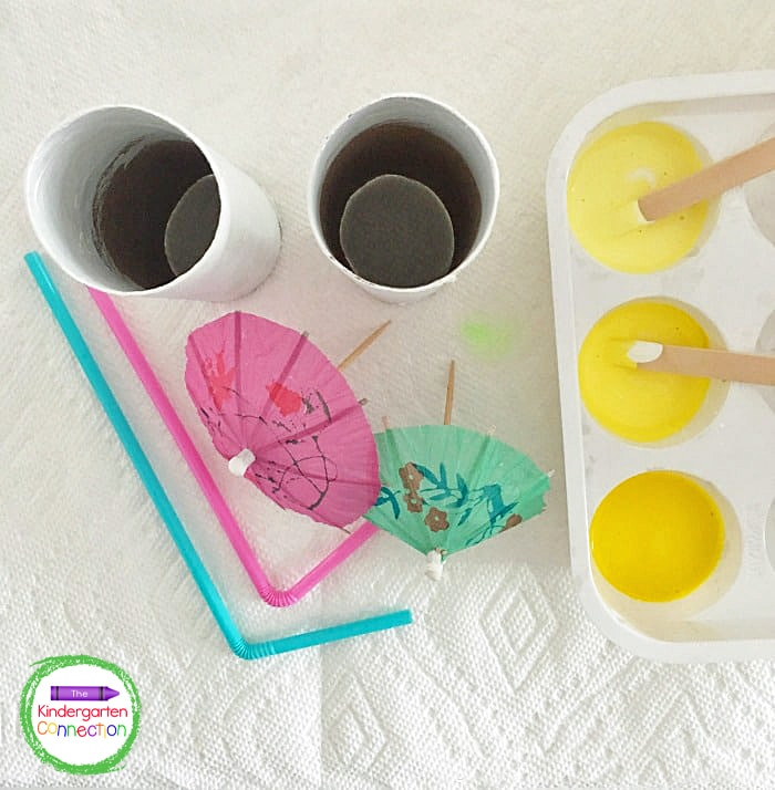 Gather your simple supplies - paint, cardboard tubes, straws, and drink umbrellas!