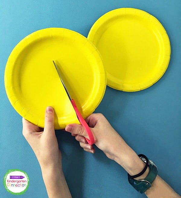 Set one paper plate aside and begin by inviting the students to cut the other paper plate in half.