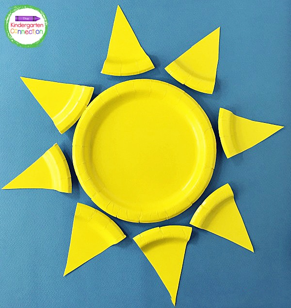 Students can arrange the pieces so they are evenly spaced around the whole paper plate that you orginally set aside.