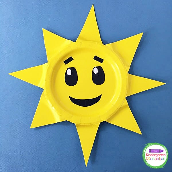 Glue the triangle rays to the rim of the plate and use construction paper to create a fun face on your sun craft.