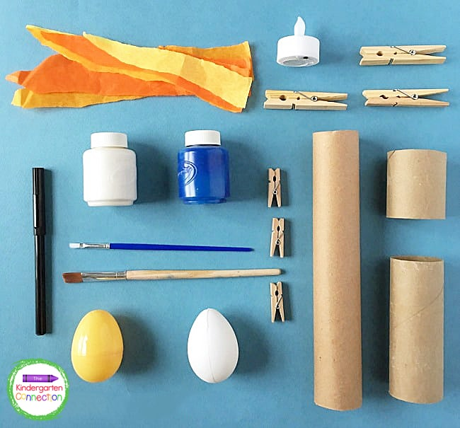 This space craft for kids is a great way to use up common supplies like old cardboard tubes, paint, and clothespins.