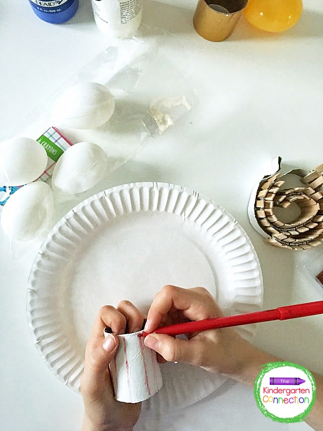 Invite students to use paint or markers to decorate their cardboard tube rockets however they would like.