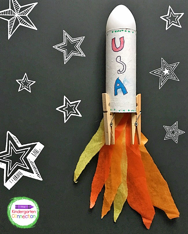Students can use tape to add strips of tissue paper to the inside of the bottom of the tube for flames before adding the clothespins.