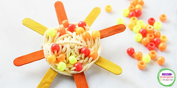 With just some popsicle sticks, yarn, and beads, you can make this beautiful sun craft.