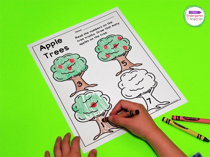 This Apple Trees printable invites students to read the numbers on the apple tree trunks, then draw that many apples on the trees.