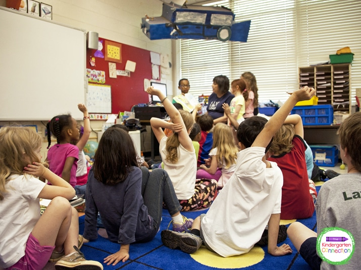 Little hands in the air usually means students are wanting to share or ask questions but they are not always related to the task at hand.