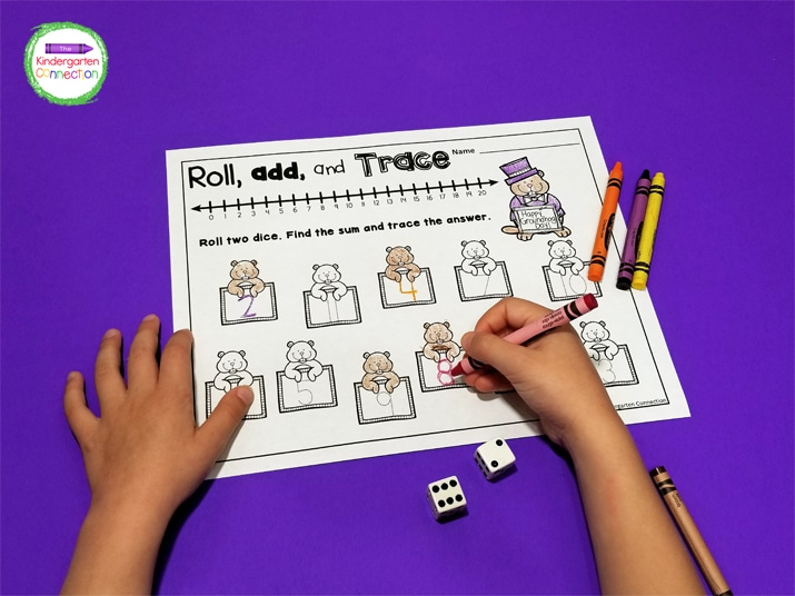 For the addition activities included, we grab two dice, roll them, count the dots, and then color the sum!