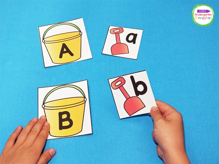To play, pull a sand pail card, say the letter, and find the matching shovel card.