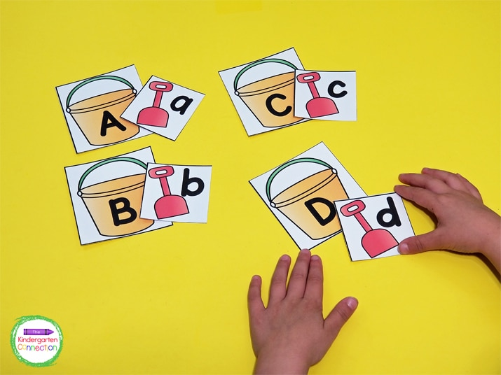 Students match the uppercase sand pail card to the lowercase shovel card.